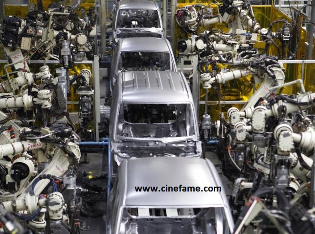 Robots assemble the main body of one of Daihatsu Motor's vehicles at the minivehicle maker's Kyushu Oita (Nakatsu) No.2 Plant in Nakatsu, Oita prefecture, Japan, April 6, 2016. REUTERS/Naomi Tajitsu/File Photo
